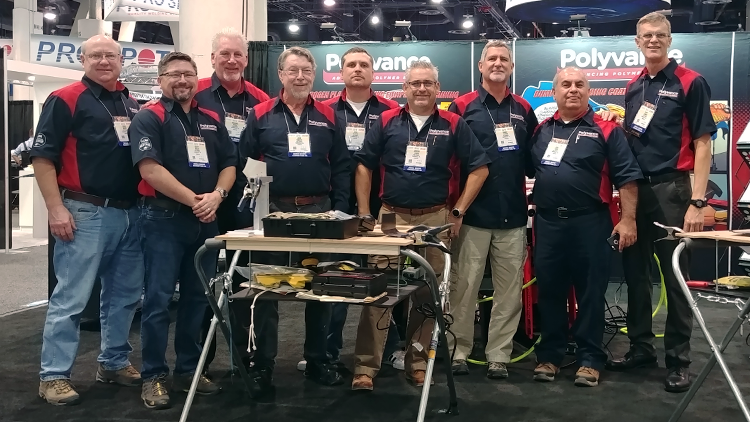 The Polyvance team in front of the booth.