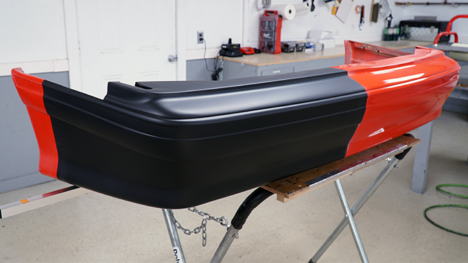 The 1993 Ford Mustang Cobra rear bumper after being primed.