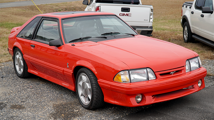 A photo shopwing the front and side of the 1993 Ford Mustang Cobra.