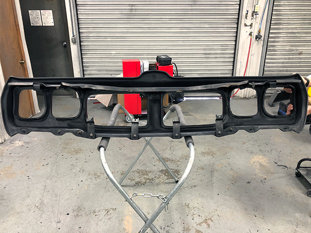 The back of the bumper after being repaired and primed.