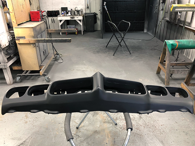 The bumper after being repaired and primed.