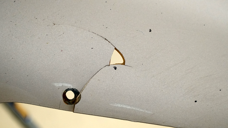 Hole in the bedside panel before repairing.