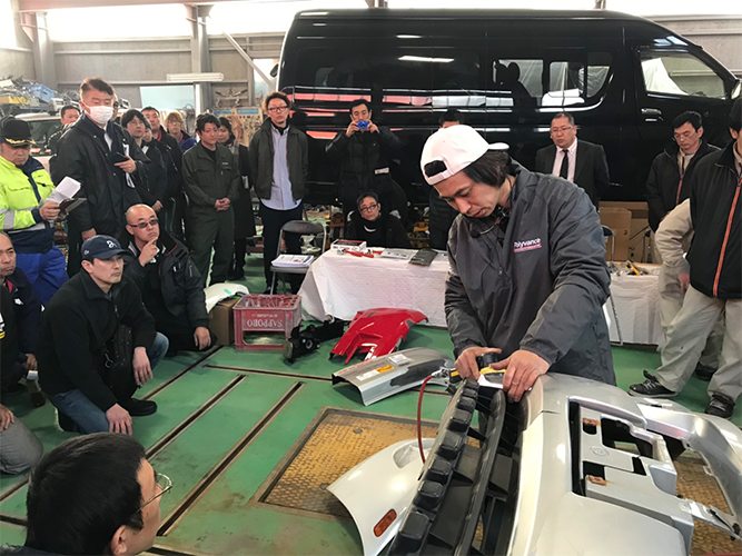 Ikuo Tanaka performing a welding demonstration for a crowd.