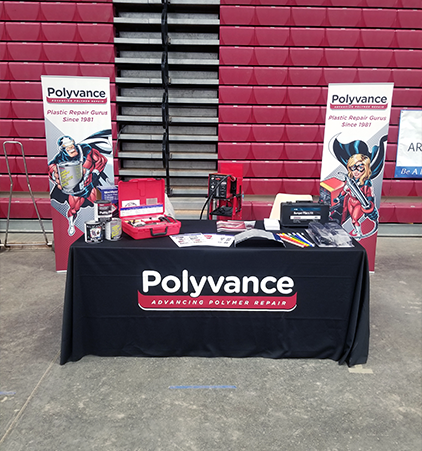 The Polyvance booth displaying a variety of plastic repair and refinishing products.