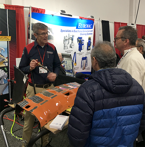 Kurt explains nitrogen plastic welding to two gentlemen