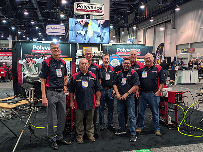 The Polyvance crew in front of the booth.