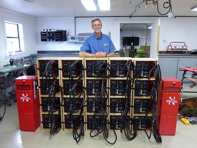 Kurt in front of a stack of 6085 Nitro Fuzer nitrogen plastic welders.