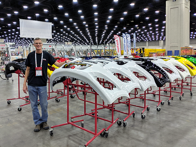 Kurt in front of 40 plastic bumpers. They have been cleaned and prepped for the SkillsUSA competition