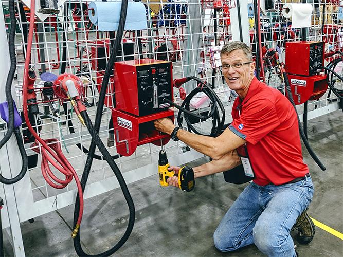 Kurt installing a nitrogen plastic welder.