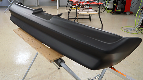 The 1978 Trans Am rear bumper after it has been repaired and primed.
