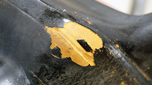 Detail of worn spots on the front bumper