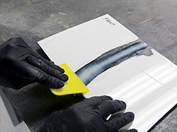 STEP 8: SMOOTH ADHESIVE INTO THE V-GROOVE WITH BODY SPREADER